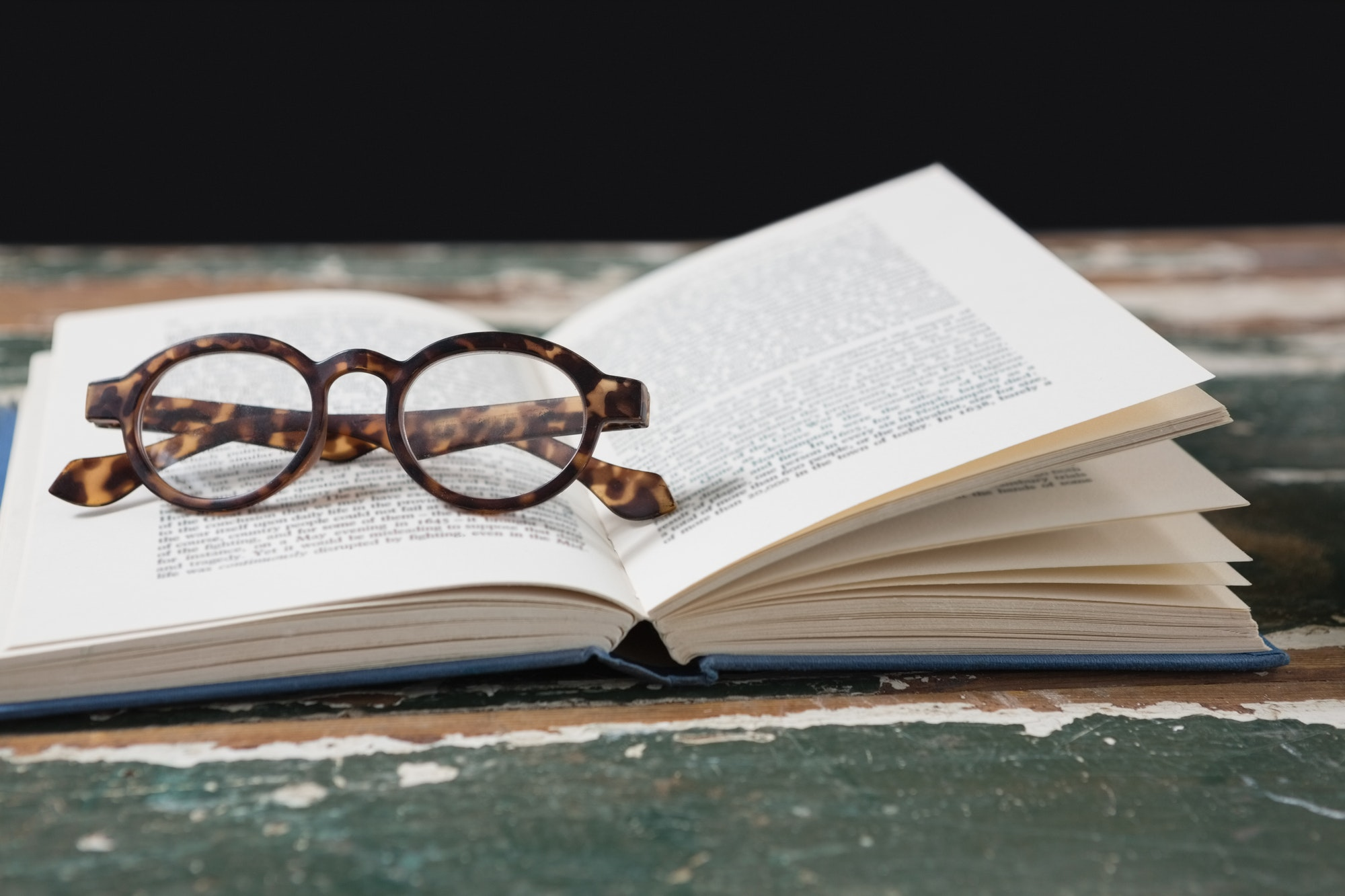 Spectacles on open book